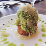 Shaved Brussels sprout salad on a risotto cake at @harvestnewhaven…